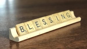 Scrabble letters that spell out BLESSING